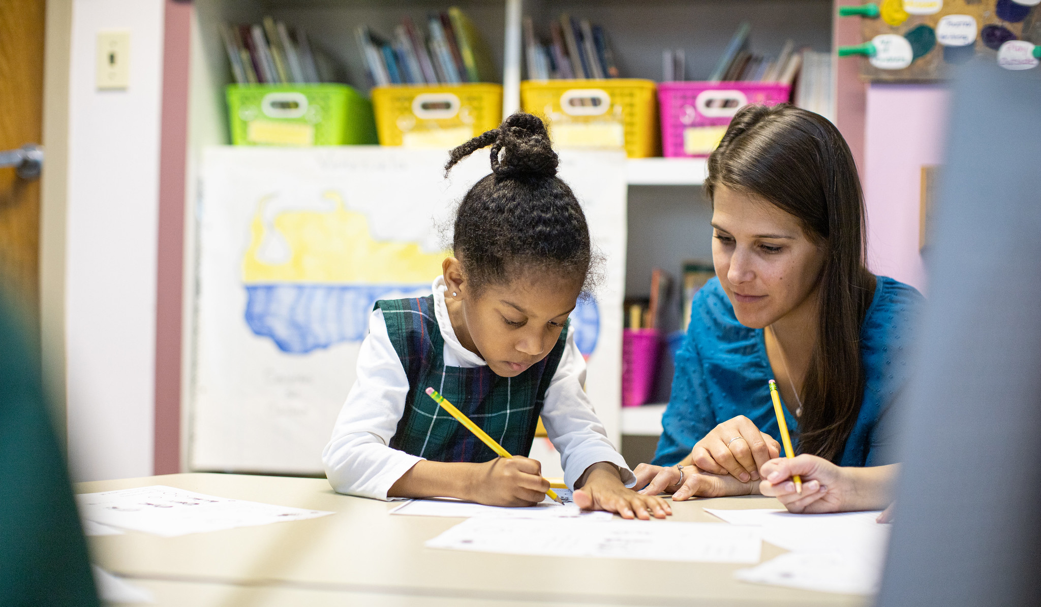 A teacher and student at The Ellis School, an all-girls private school in Pittsburgh, work together in a classroom.